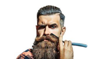 Hipster stutzt seinen Bart